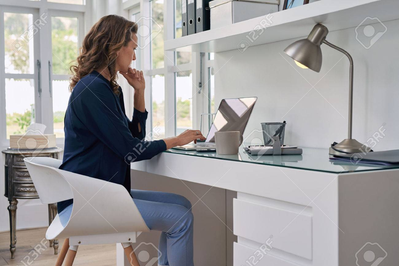 businesswoman entrepreneur working on laptop from home office space - 49226045