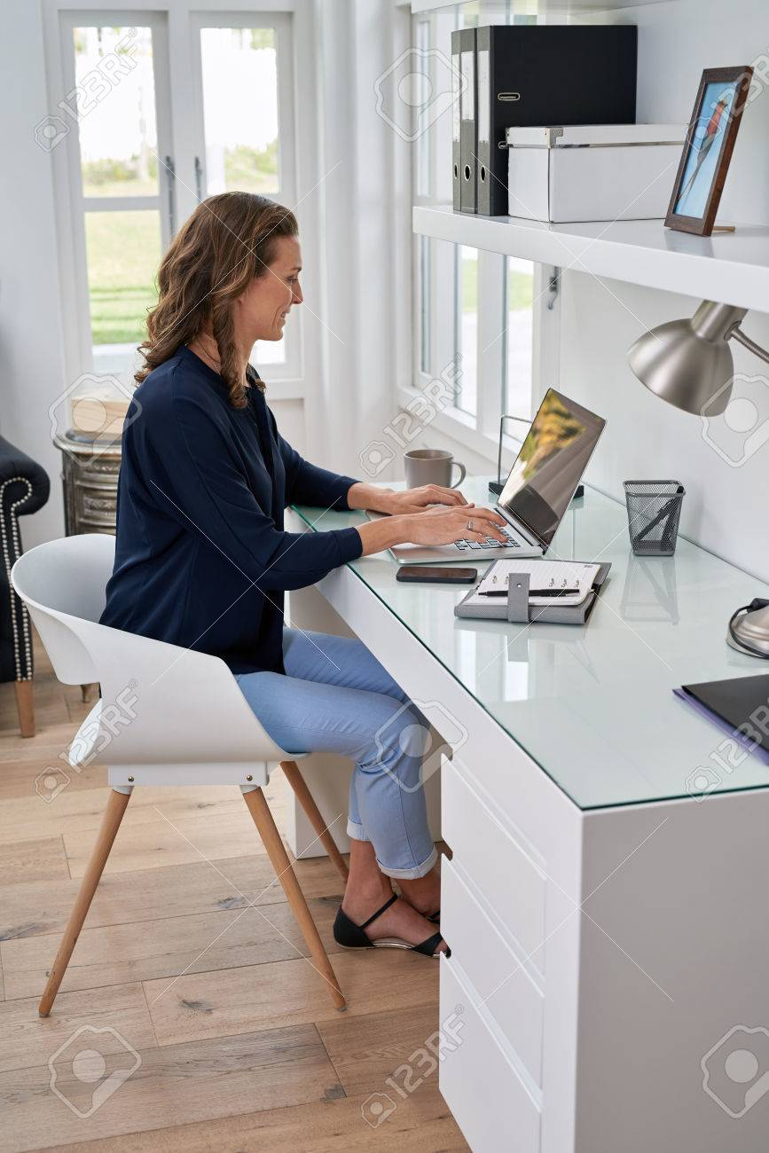 businesswoman entrepreneur working on laptop from home office space - 49227847