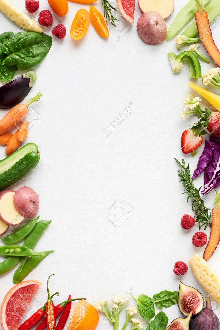 Food background border frame flatlay overhead of colorful fresh produce raw vegetables, carrot chilli cucumber purple cabbage spinach rosemary herb, plenty of copy-space in middle - 61082886