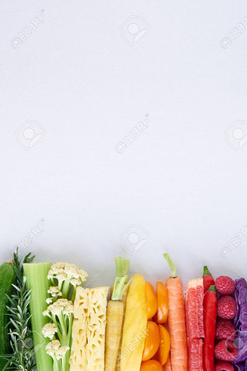 colorful food background, frame border of rainbow spectrum gradient of organic fresh fruit and vegetables - 61082891