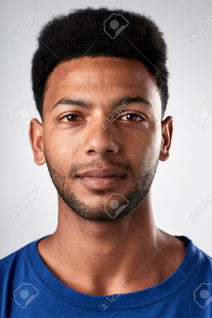 Portrait of real black african man with no expression ID or passport photo full collection of diverse face and expressions - 65426114