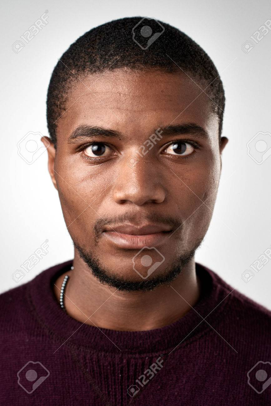 Portrait of real black african man with no expression ID or passport photo full collection of diverse face and expressions - 65513586