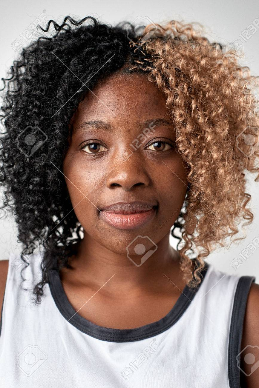 Portrait of real black african woman with no expression ID or passport photo full collection of diverse face and expressions - 65513975
