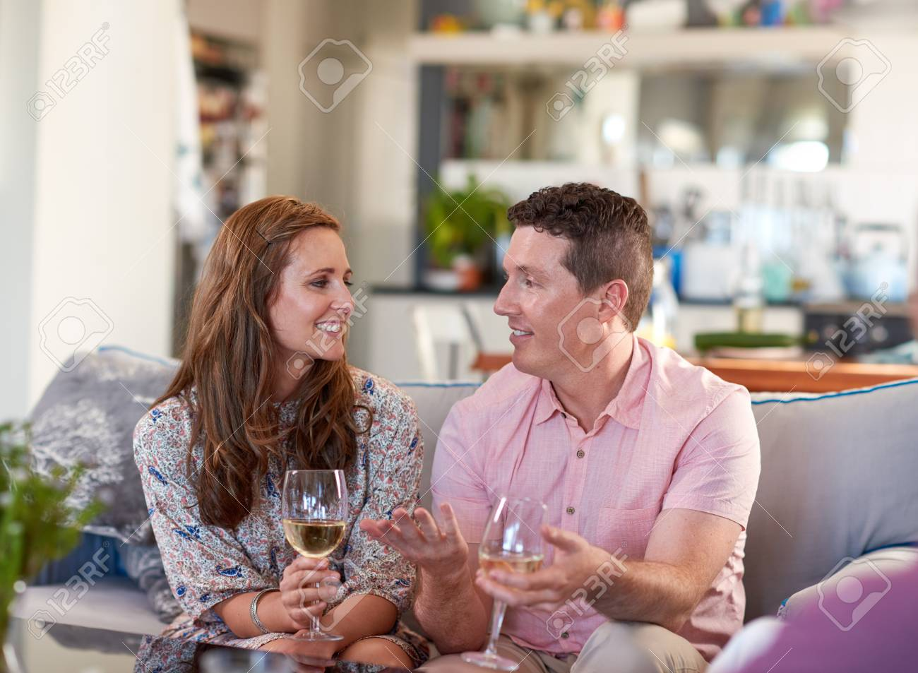 Real Couple Talking Chatting Enjoying Glass Of Wine On The Couch Stock Photo Picture And Royalty Free Image Image 73770546