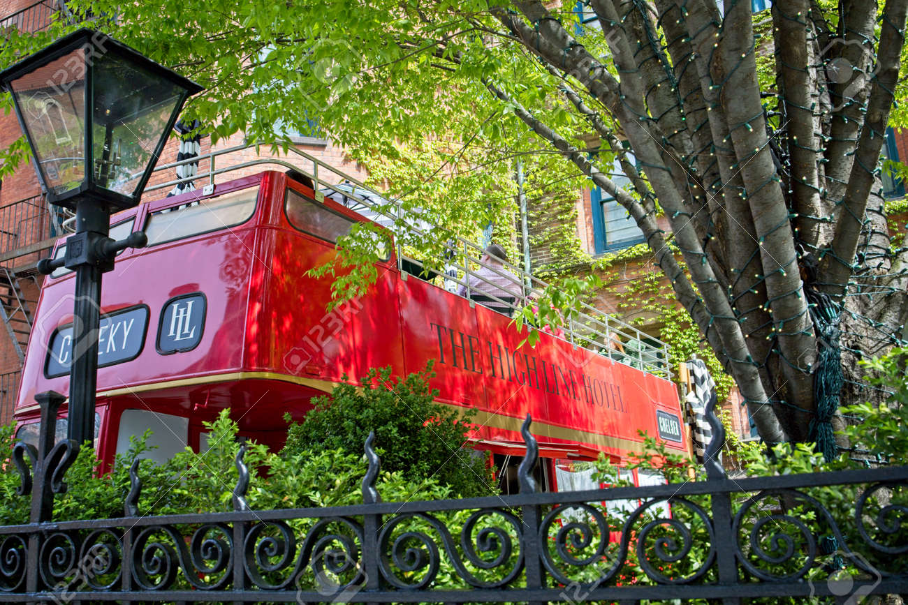 New York, NY, USA - May 5, 2021: A London bus used for dining on the grounds of the High Line Hotel in Chelsea - 168631697
