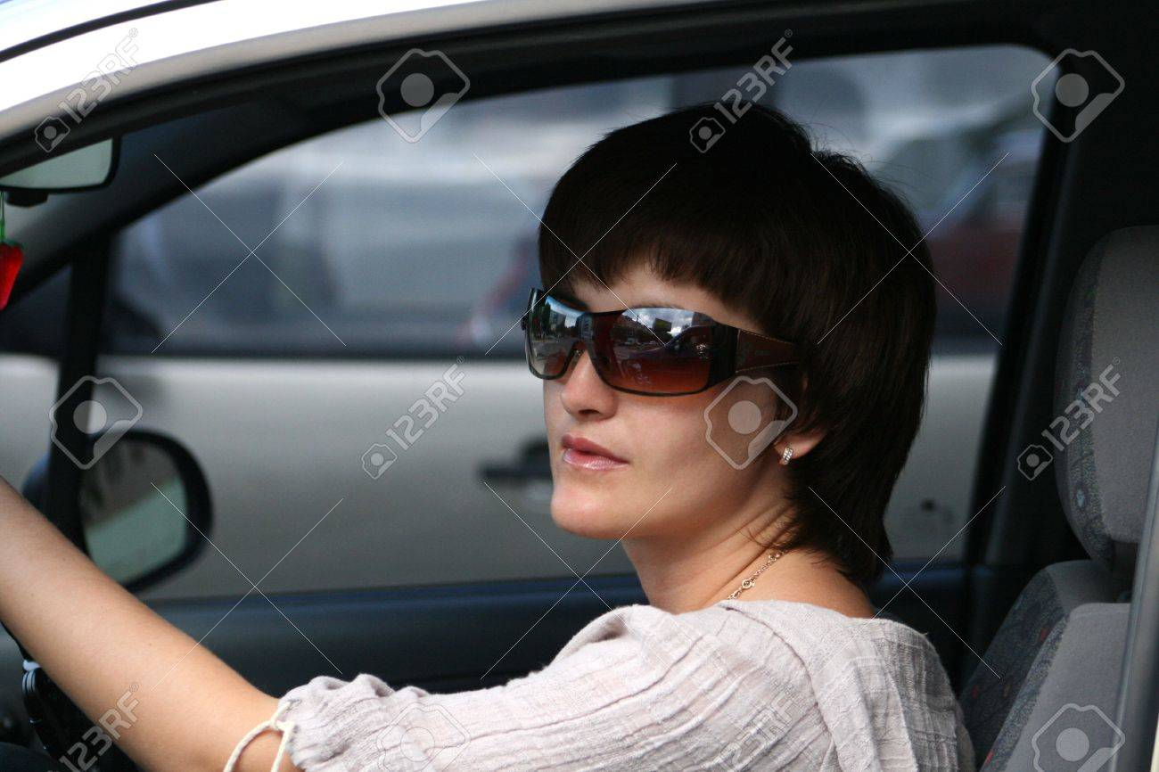 The girl in the automobile - the neighbour in an automobile jam Stock Photo - 1007638