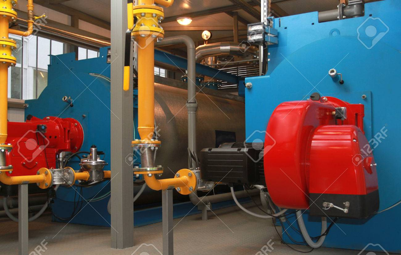 Blue Boilers And Red Gas Burners In A Modern Boiler-house Stock ...