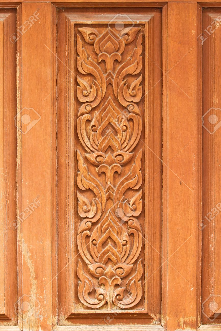 thai delicate pattern carved on temple wooden door Stock Photo - 18452577 & Thai Delicate Pattern Carved On Temple Wooden Door Stock Photo ... Pezcame.Com