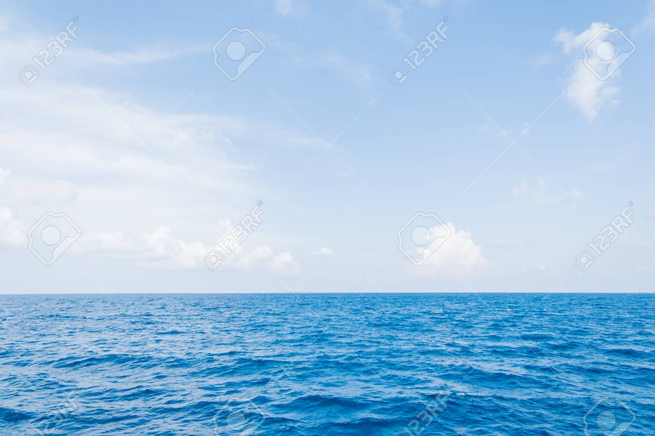 Calm Sea and Blue Sky Background in Maldives - 124608707