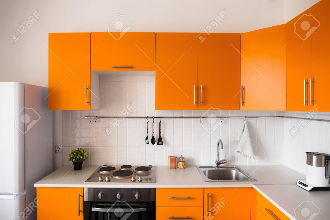 Orange kitchen set in modern style stock photo 64328504
