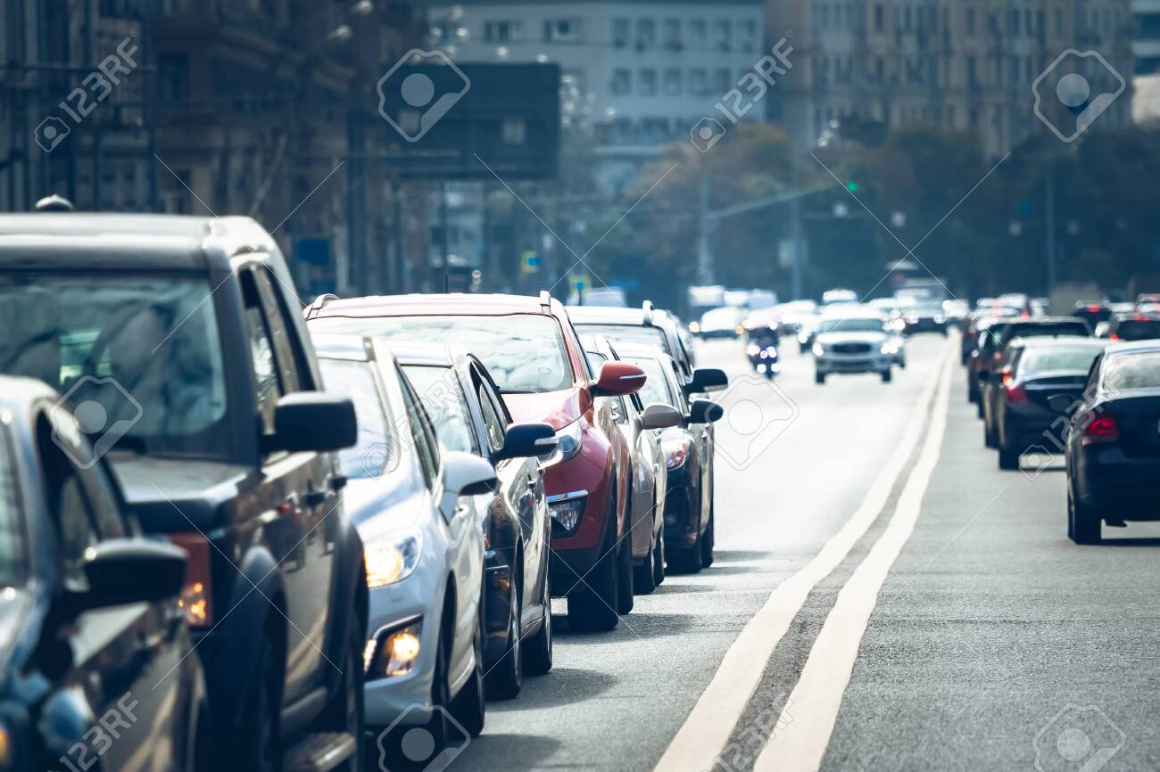 Cars standing in a line during traffic jam - 153219192