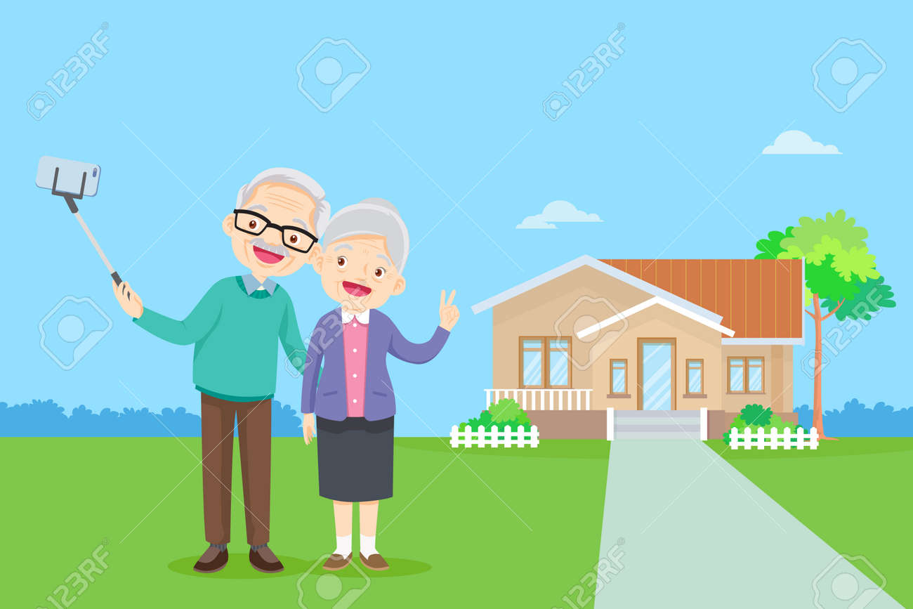 elderly couple and making photo together on mobile phone with selfie stick.Old man and woman take selfie on smartphone in front of home - 166467597
