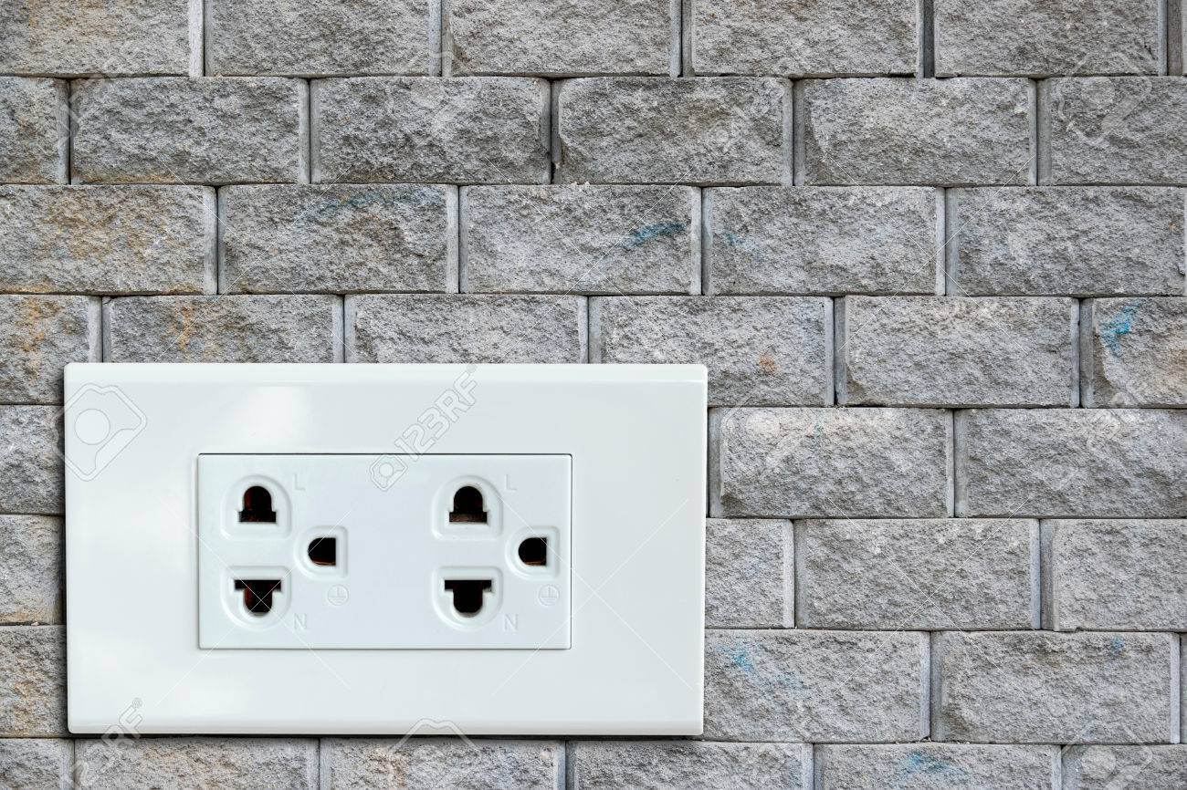 AC Power Plug On The Vintage Brick Wall. Stock Photo, Picture And ...