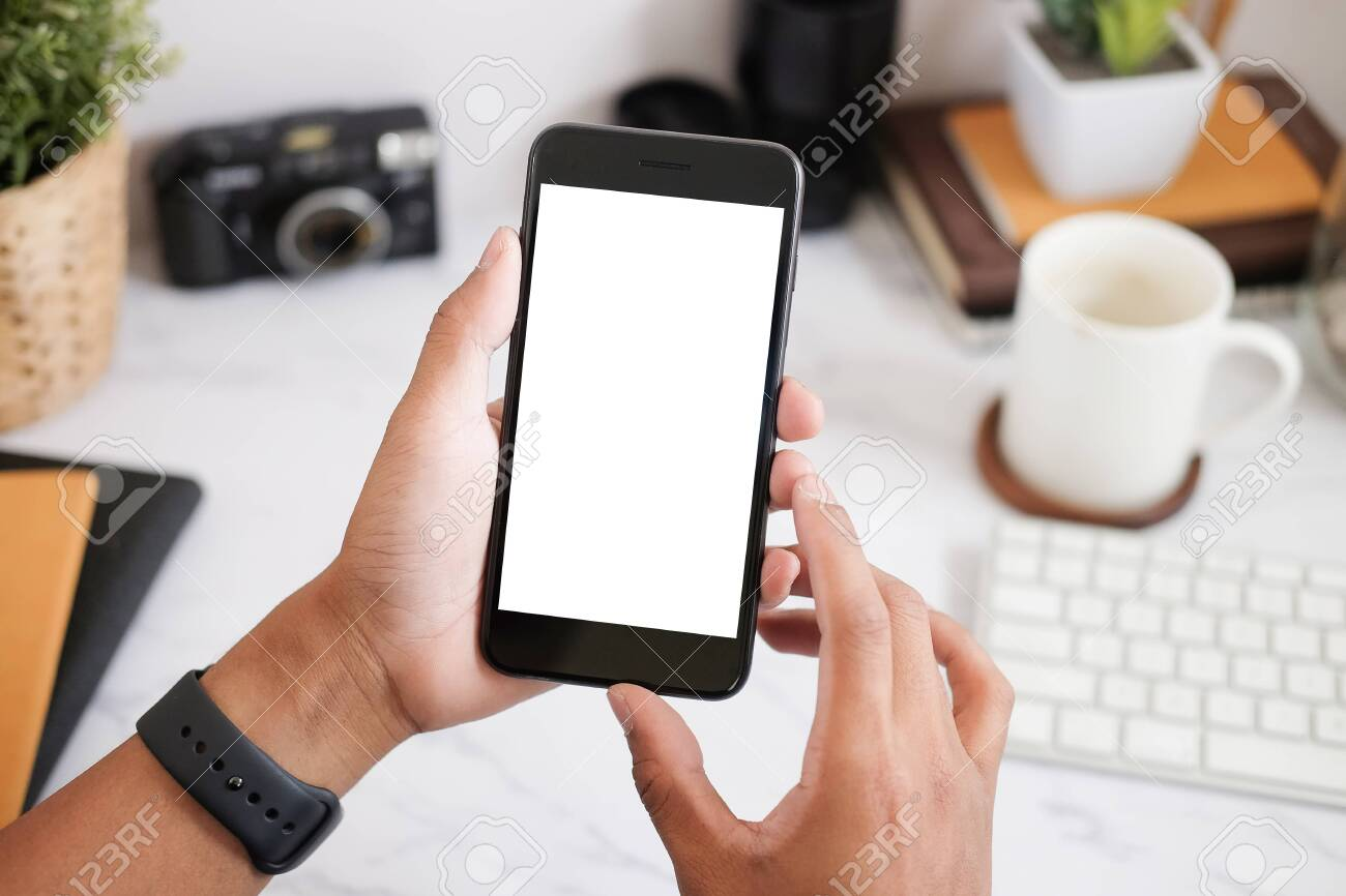 Cropped shot view of man hands holding smart phone with blank copy space screen for your text message or information content, female reading text message on cell telephone during in urban setting. - 146422815