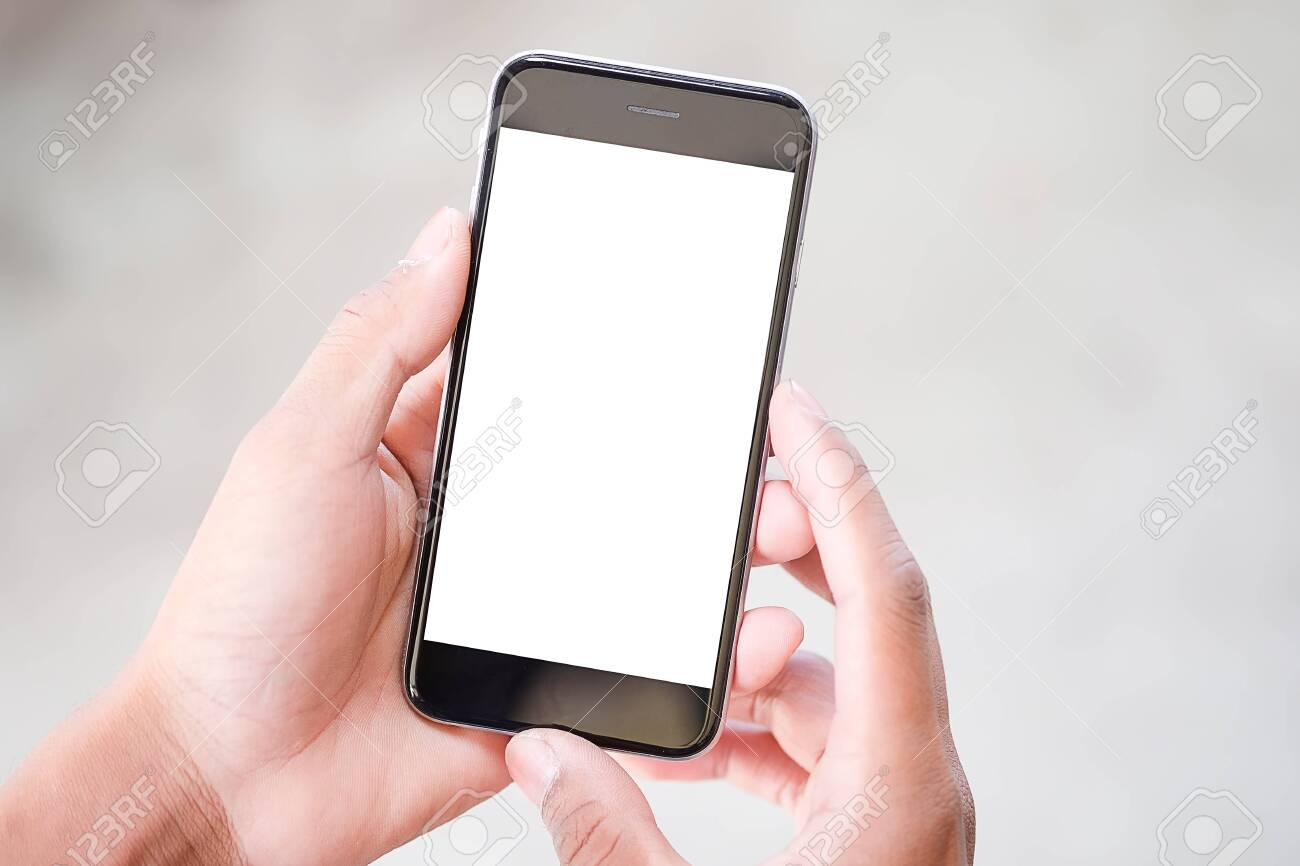 Cropped shot view of man hands holding smart phone with blank copy space screen for your text message or information content, female reading text message on cell telephone during in urban setting. - 156511933