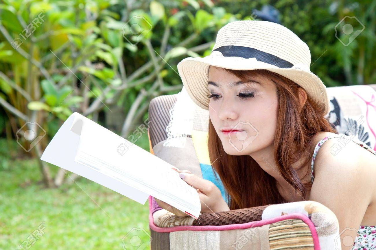 Beautiful asian woman reading her book in the garden Stock Photo - 13542386