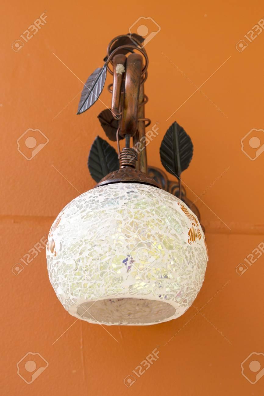 Classic lamp on the orange wall Stock Photo - 24969723
