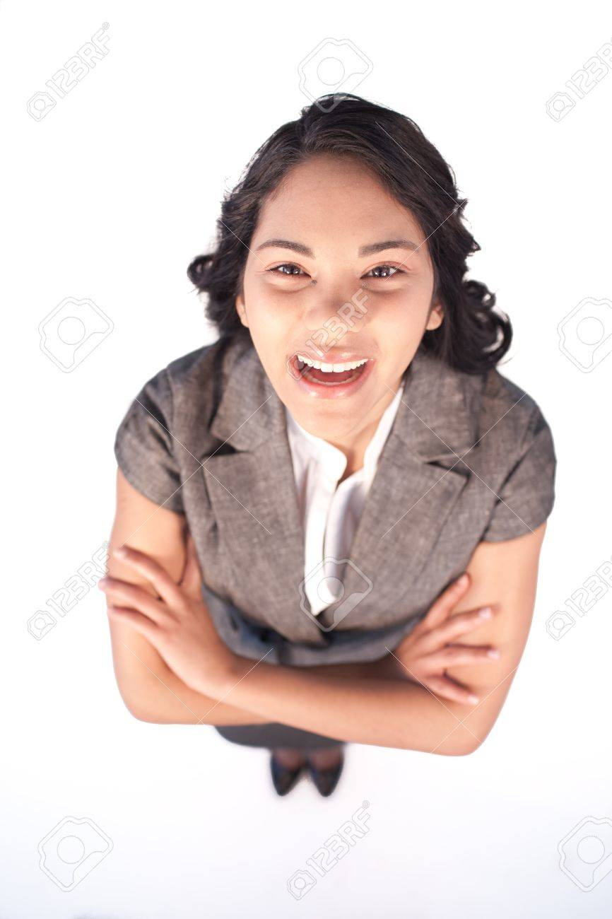 High angle of businesswoman laughing at the camera Stock Photo - 10072649