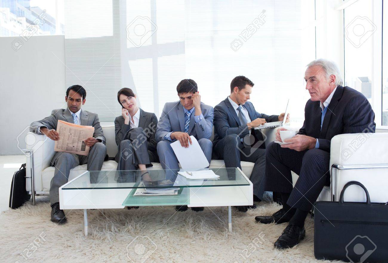 business people sitting and waiting for a job interview stock business people sitting and waiting for a job interview stock photo 10094684