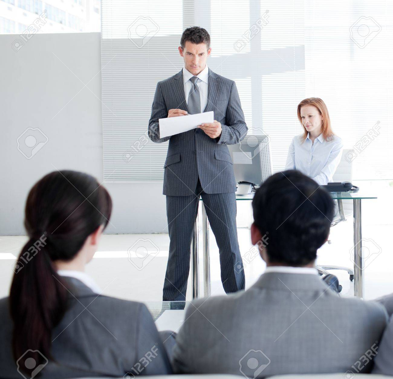 An attractive teamleader talking to his colleagues Stock Photo - 10077123