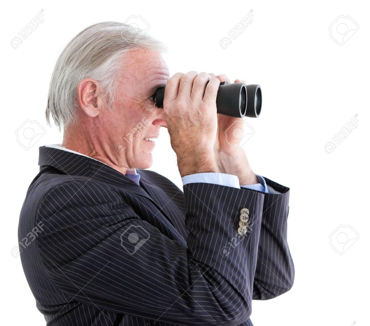 Confident businessman looking through binoculars Stock Photo - 10093315
