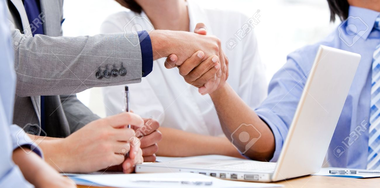 Close-up of business partners shaking hands Stock Photo - 10078385
