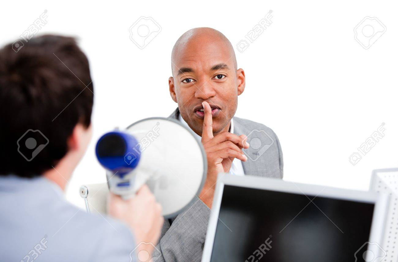Confident businessman asking for silece while his colleague yelling through a megaphone Stock Photo - 10078051