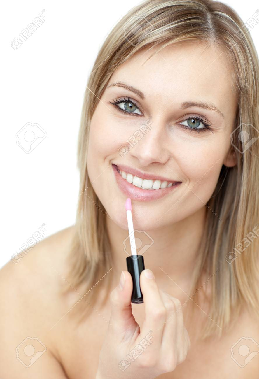 Smiling woman putting gloss Stock Photo - 10093936