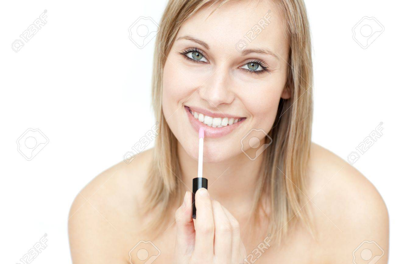 Attractive woman putting gloss Stock Photo - 10078578