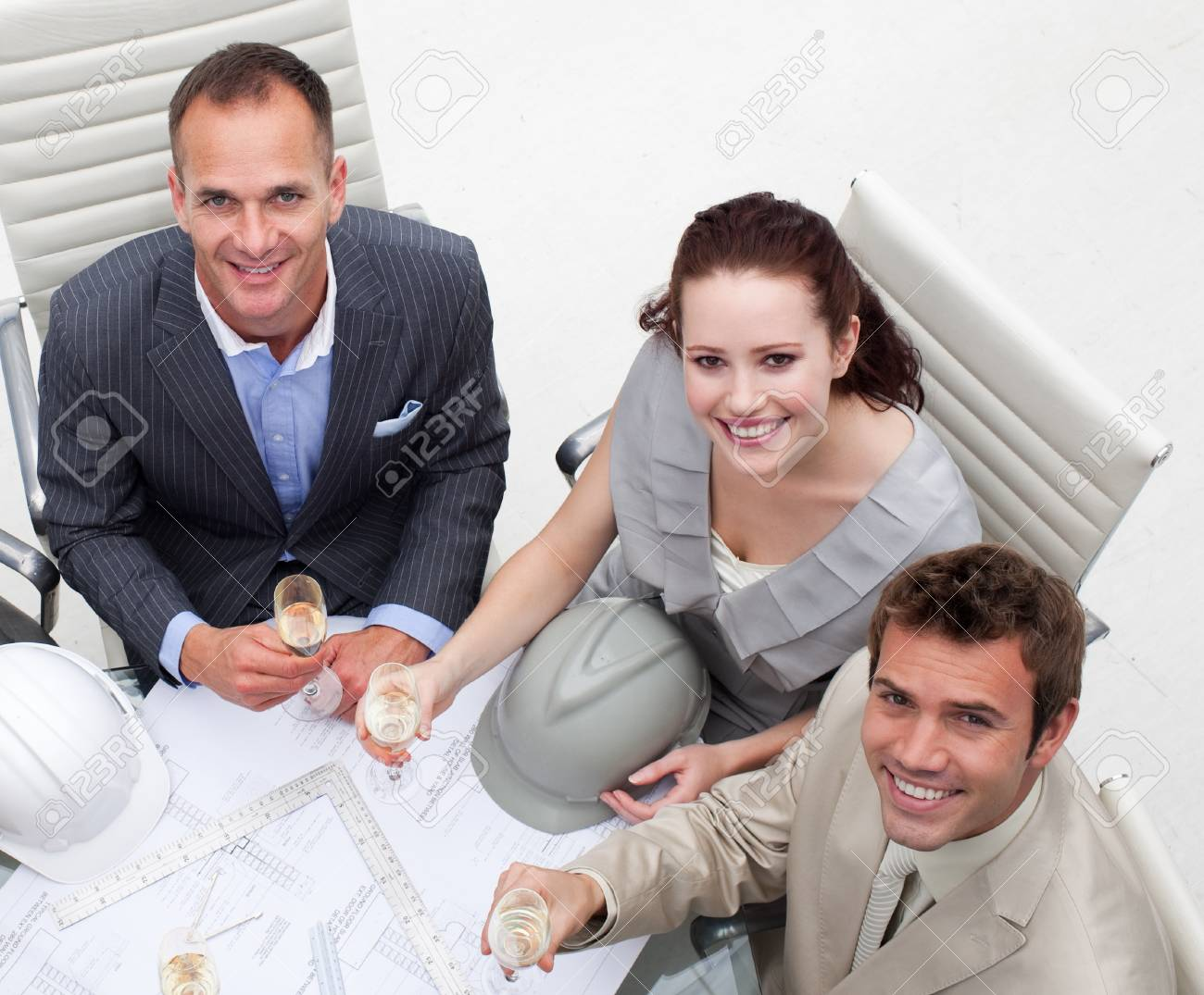 Happy architects drinking champagne in the office Stock Photo - 10076872