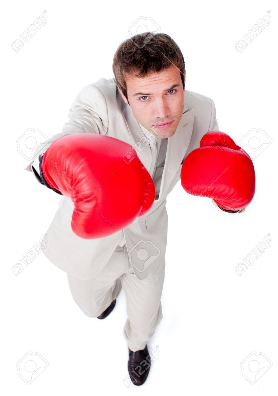 Handsome businessman using boxing gloves Stock Photo - 10076085