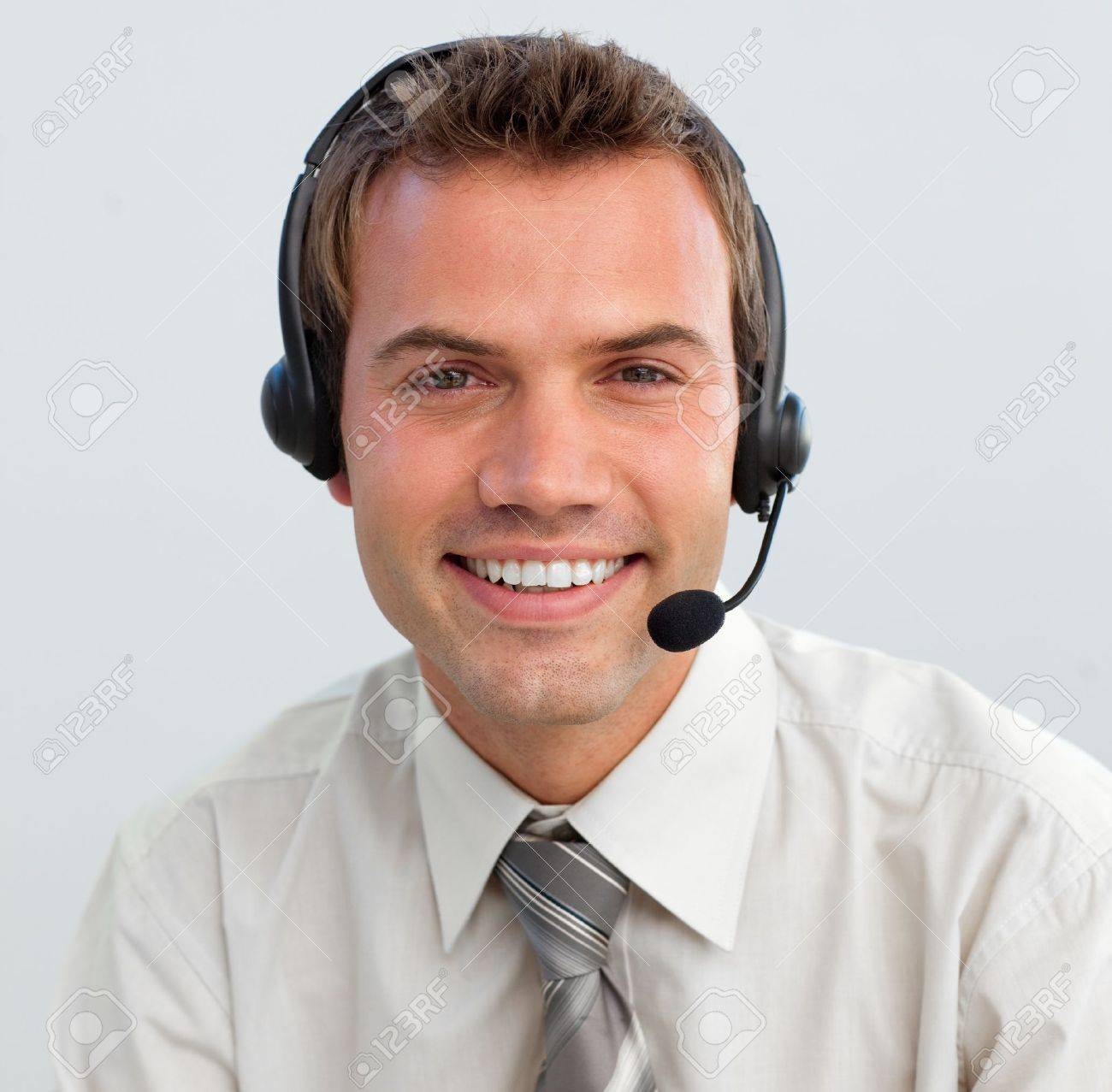Portrait of a smiling businessman with a headset on Stock Photo - 10078311