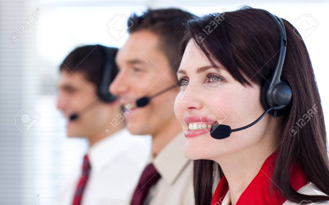 Happy co-workers with headsets on Stock Photo - 10078791
