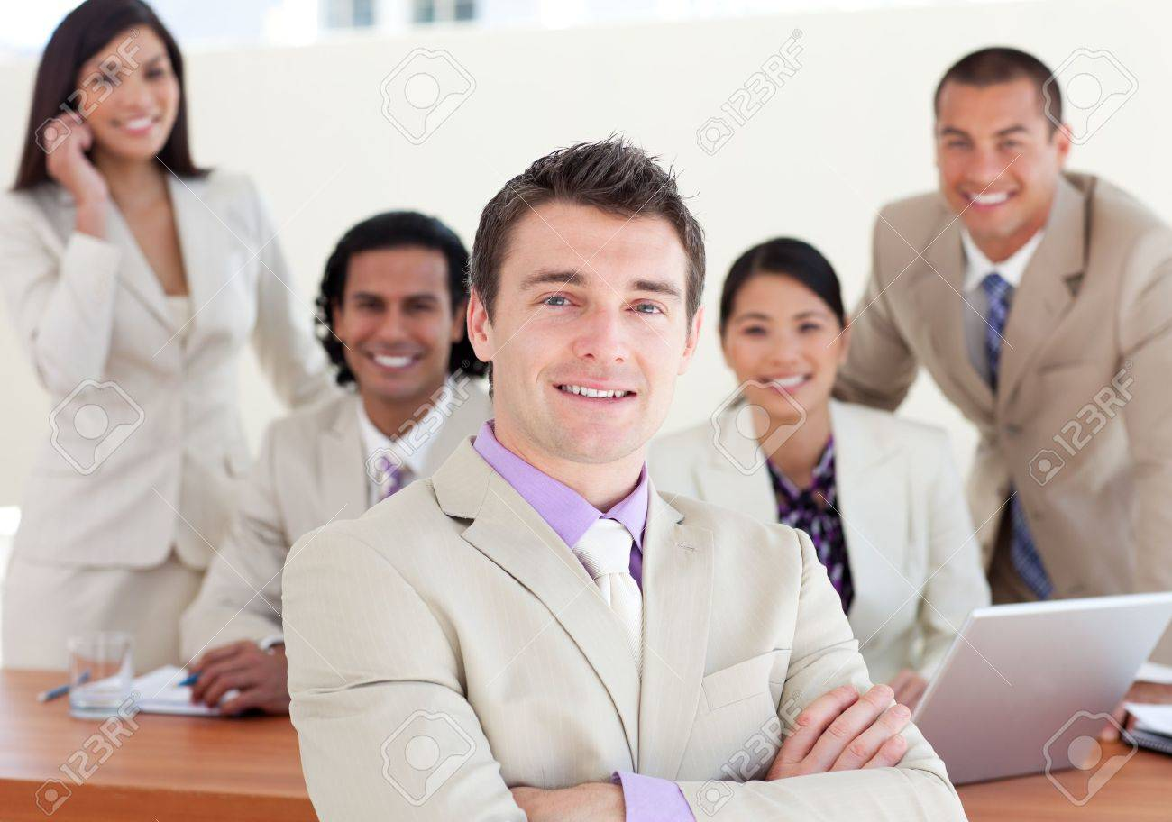 Confident manager with folded arms in front of his team Stock Photo - 10093534