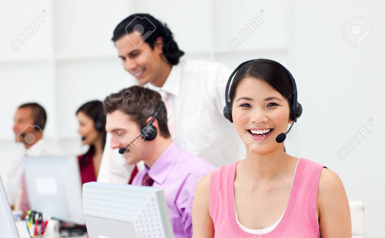 Portrait of an Asian customer agent and her team Stock Photo - 10092834