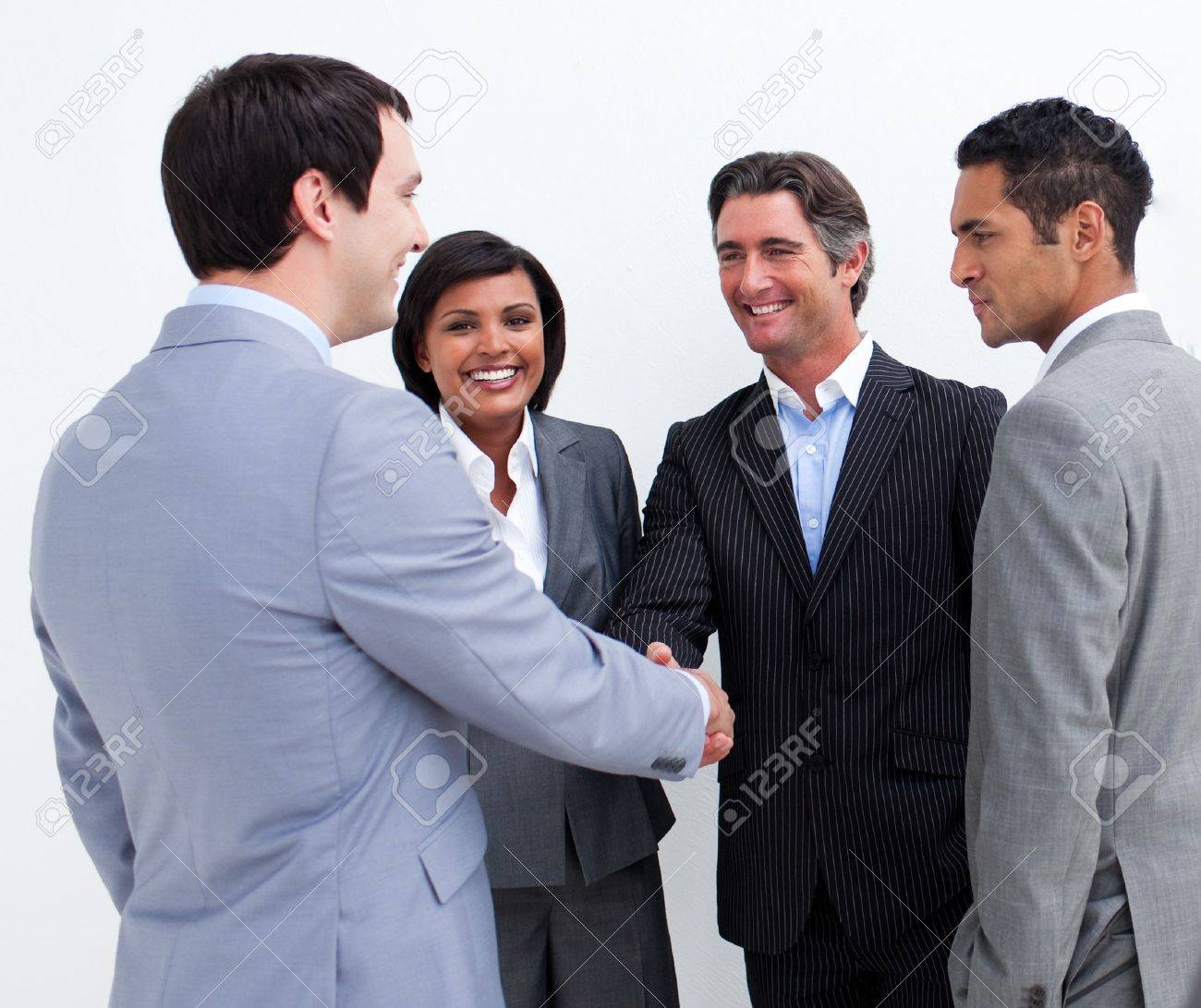 Business people handshake greeting deal at work photo free download - Business Deal International Business People Closing A Deal