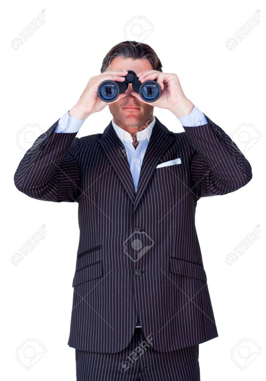 Serious businessman using binoculars Stock Photo - 10078452