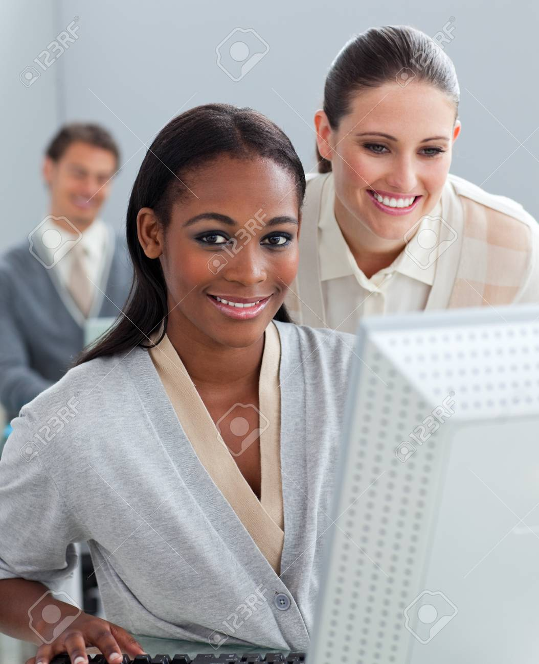 Portrait of two businesswomen working at a computer Stock Photo - 10097312