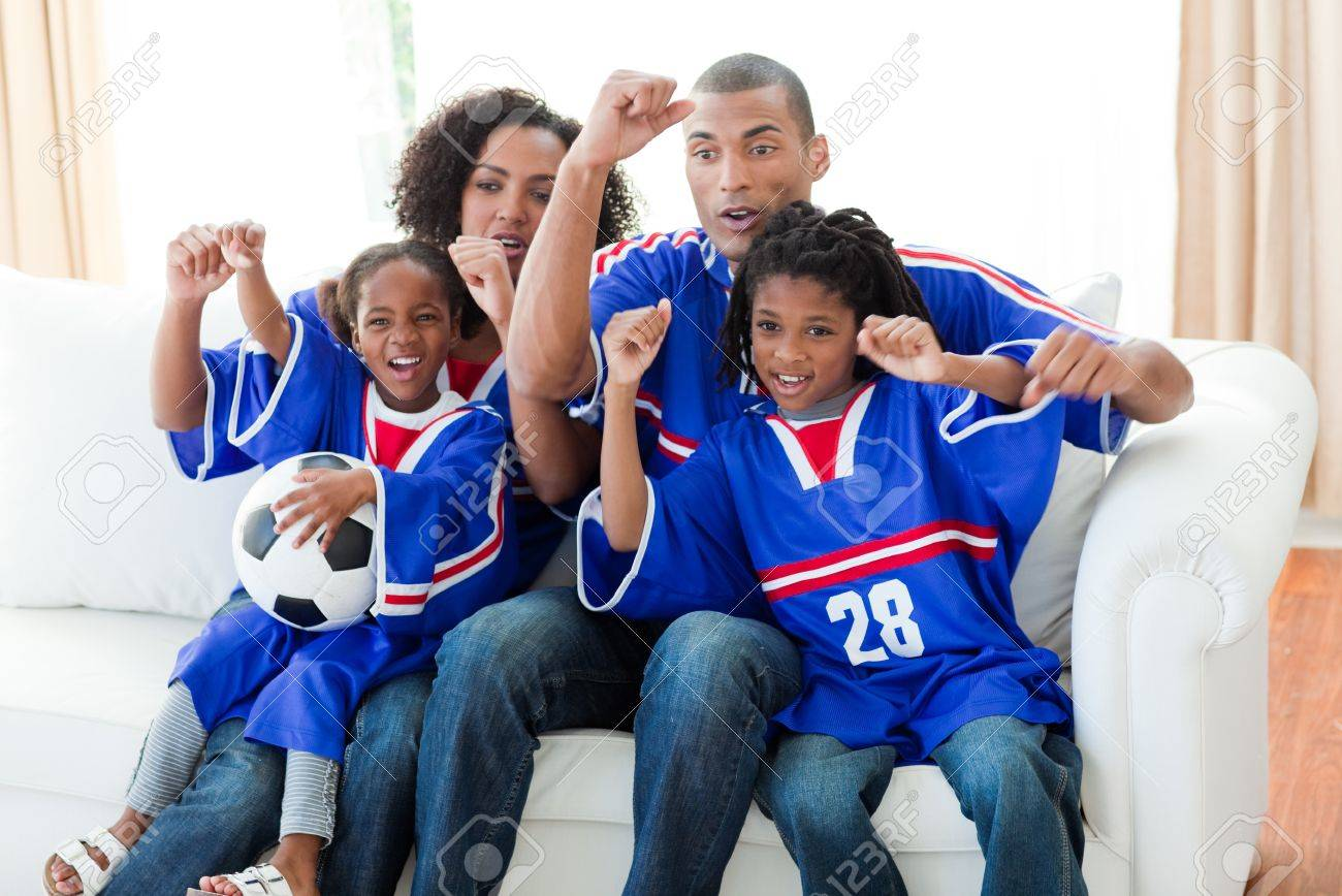 Afro-American family celebrating a goal at home Stock Photo - 10097192