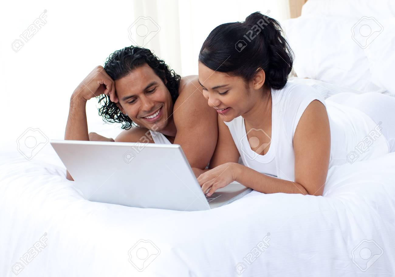 Smiling couple lying on the bed Stock Photo - 10094961