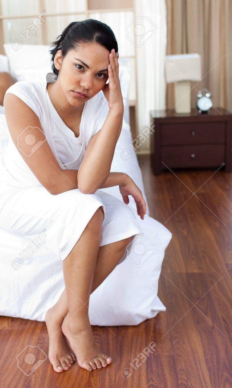 Angry woman sitting on the bed Stock Photo - 10095409