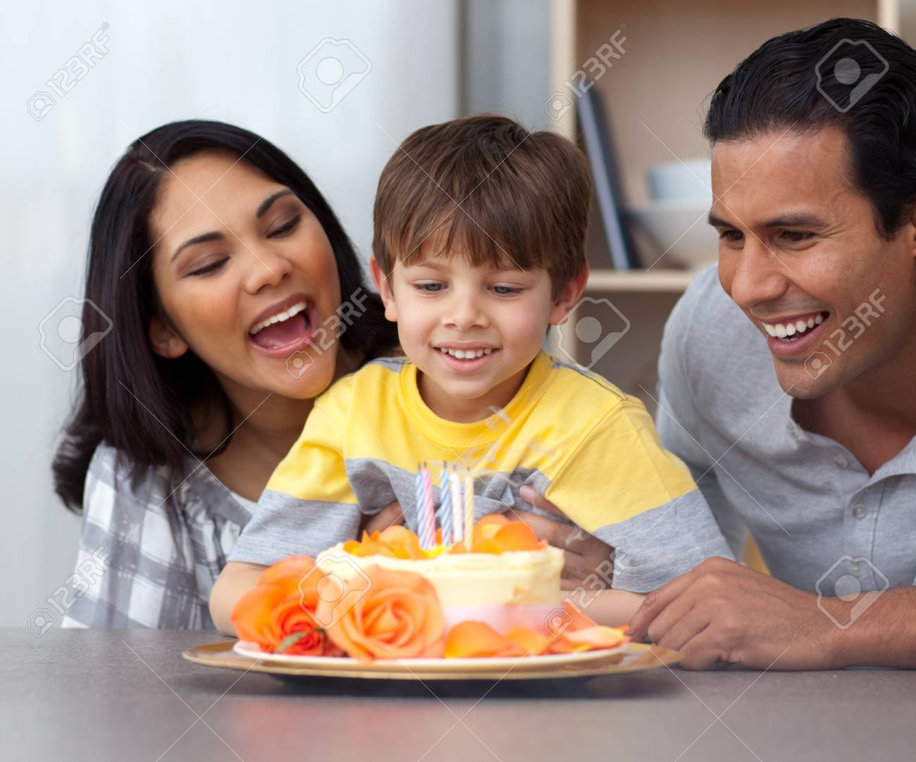 Close-up of child celebrating his birthday with his parents Stock Photo - 10095601