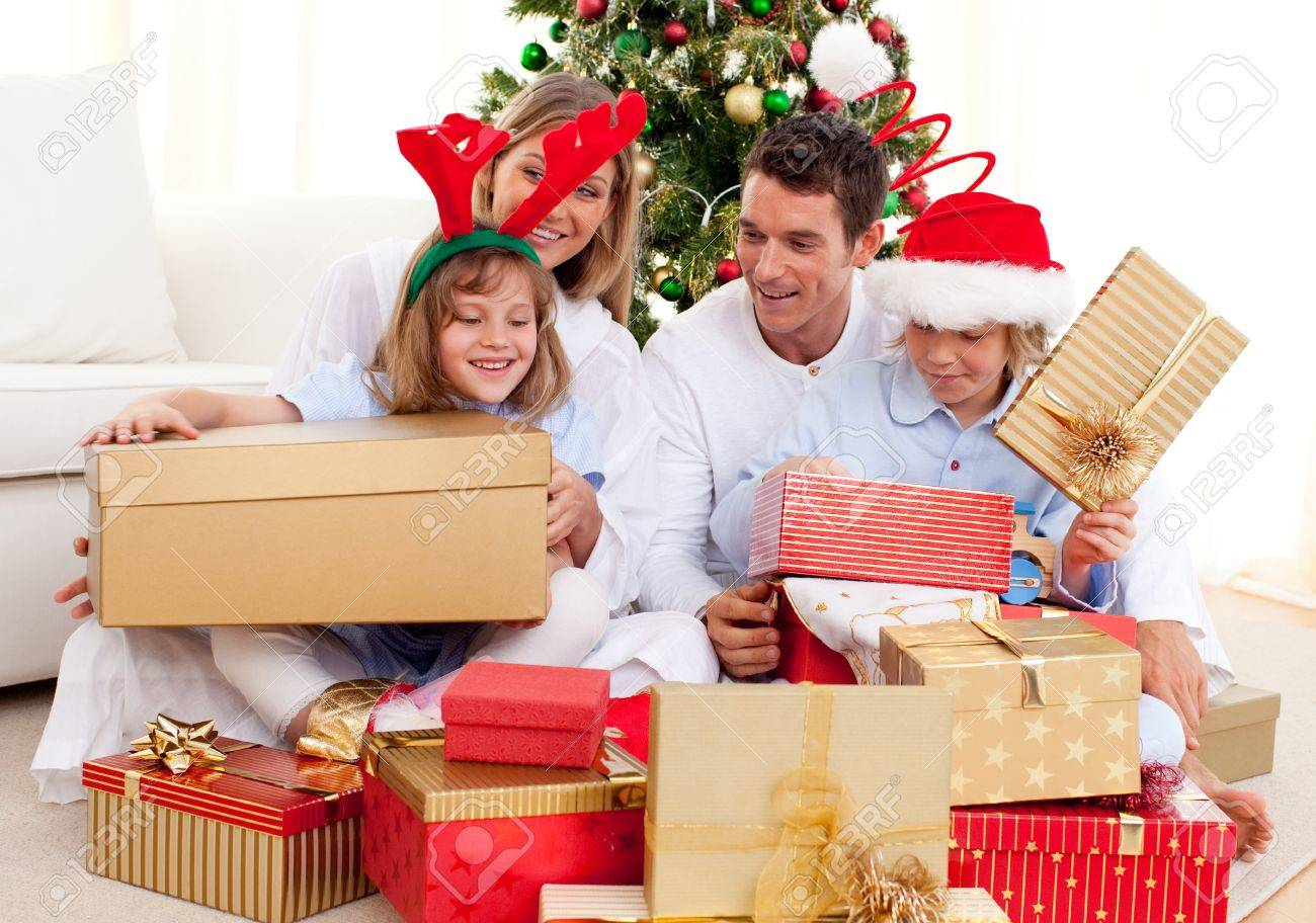 Young Family Having Fun With Christmas Gifts Stock Photo, Picture ...