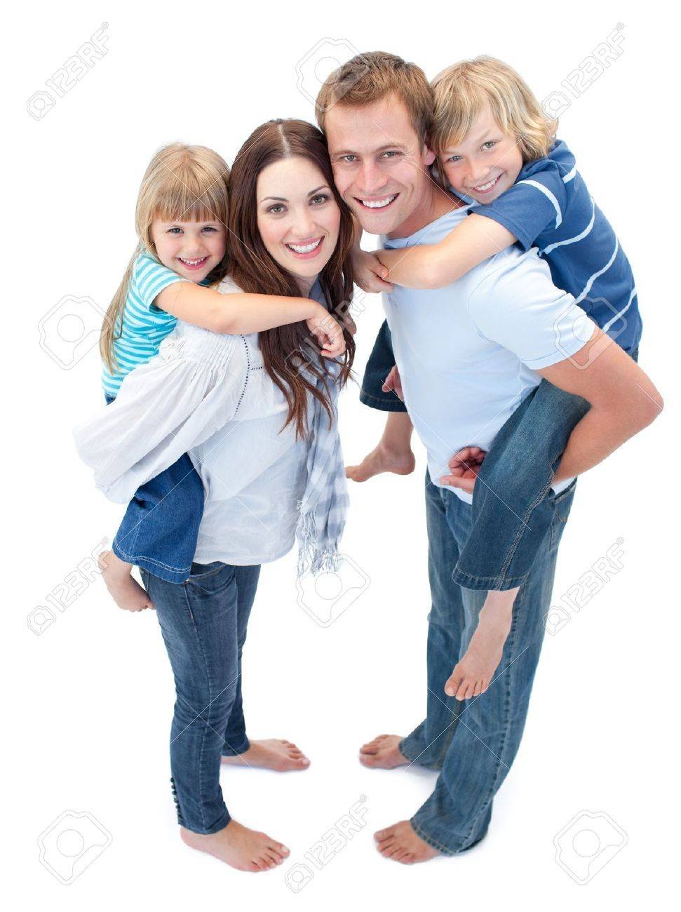 Smiling Family Against A White Background - 10096270