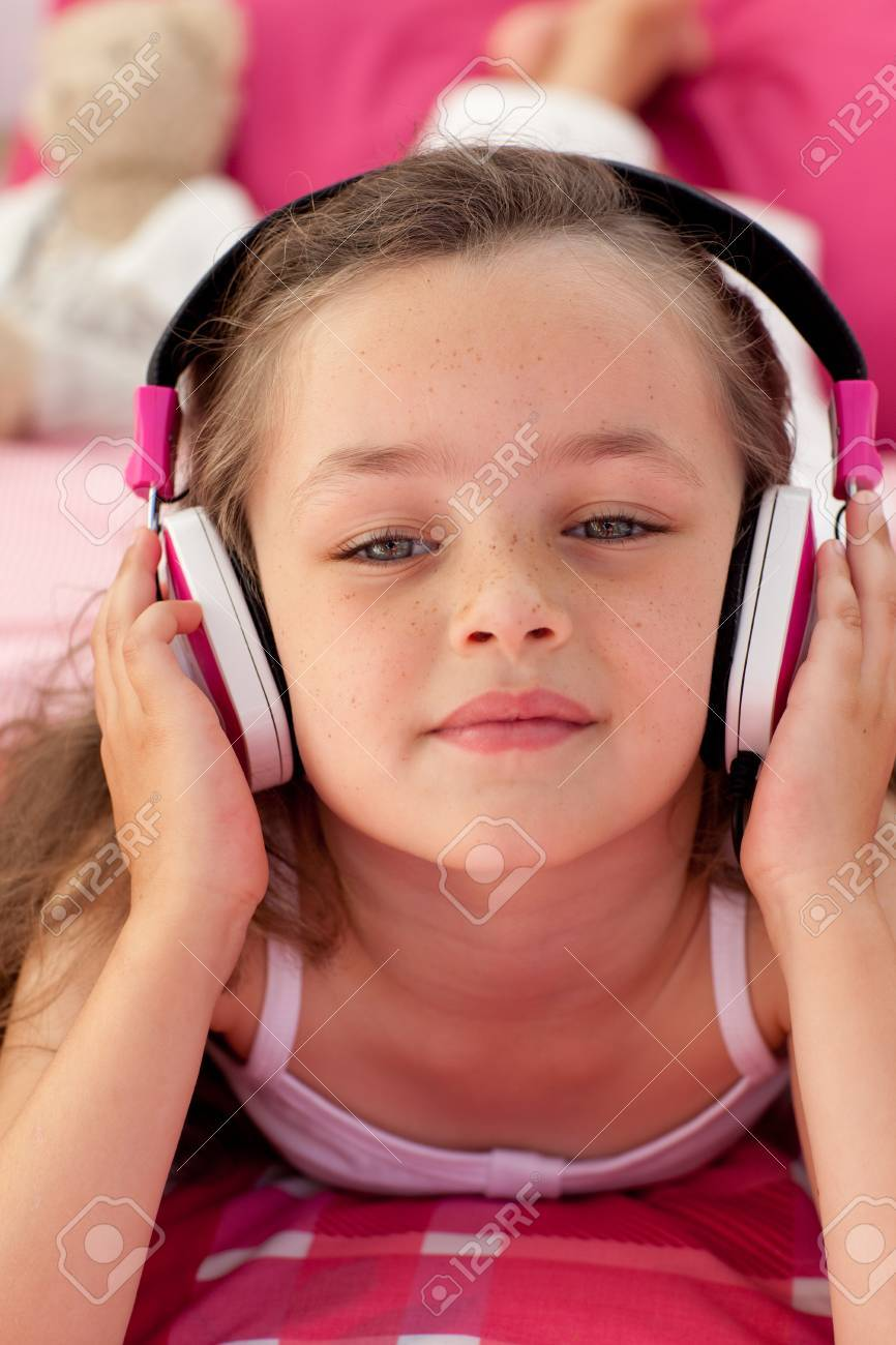 Close-up of a little girl listening musc Stock Photo - 10105984
