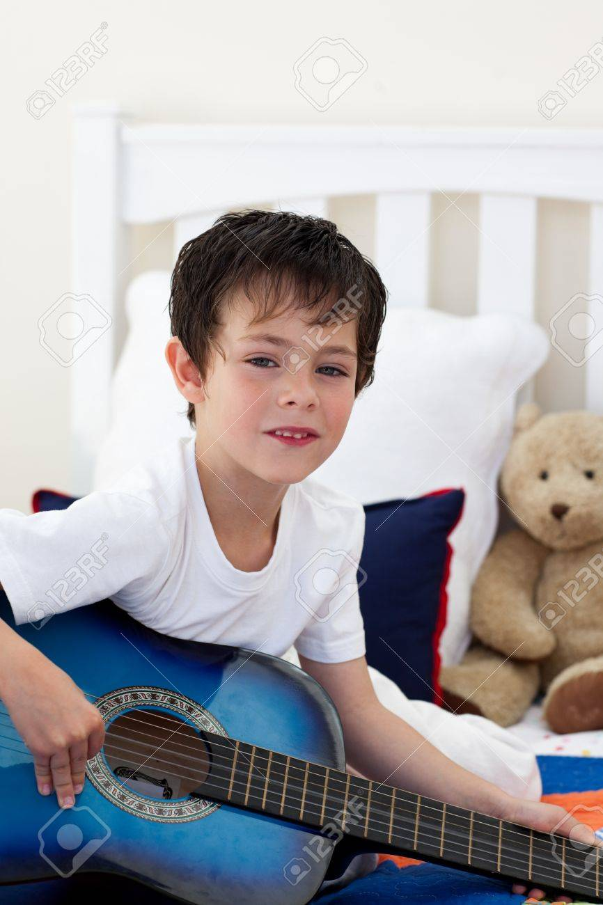Portrait of a little boy playing guitar Stock Photo - 10097245