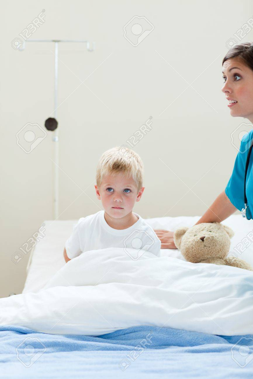 Portrait of a sick little boy on a hospital bed Stock Photo - 10096586