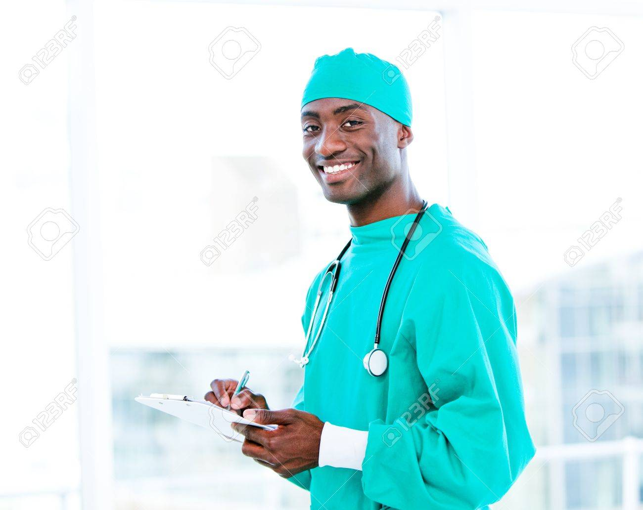 Attractive surgeon making notes in a patient's folder Stock Photo - 10106297