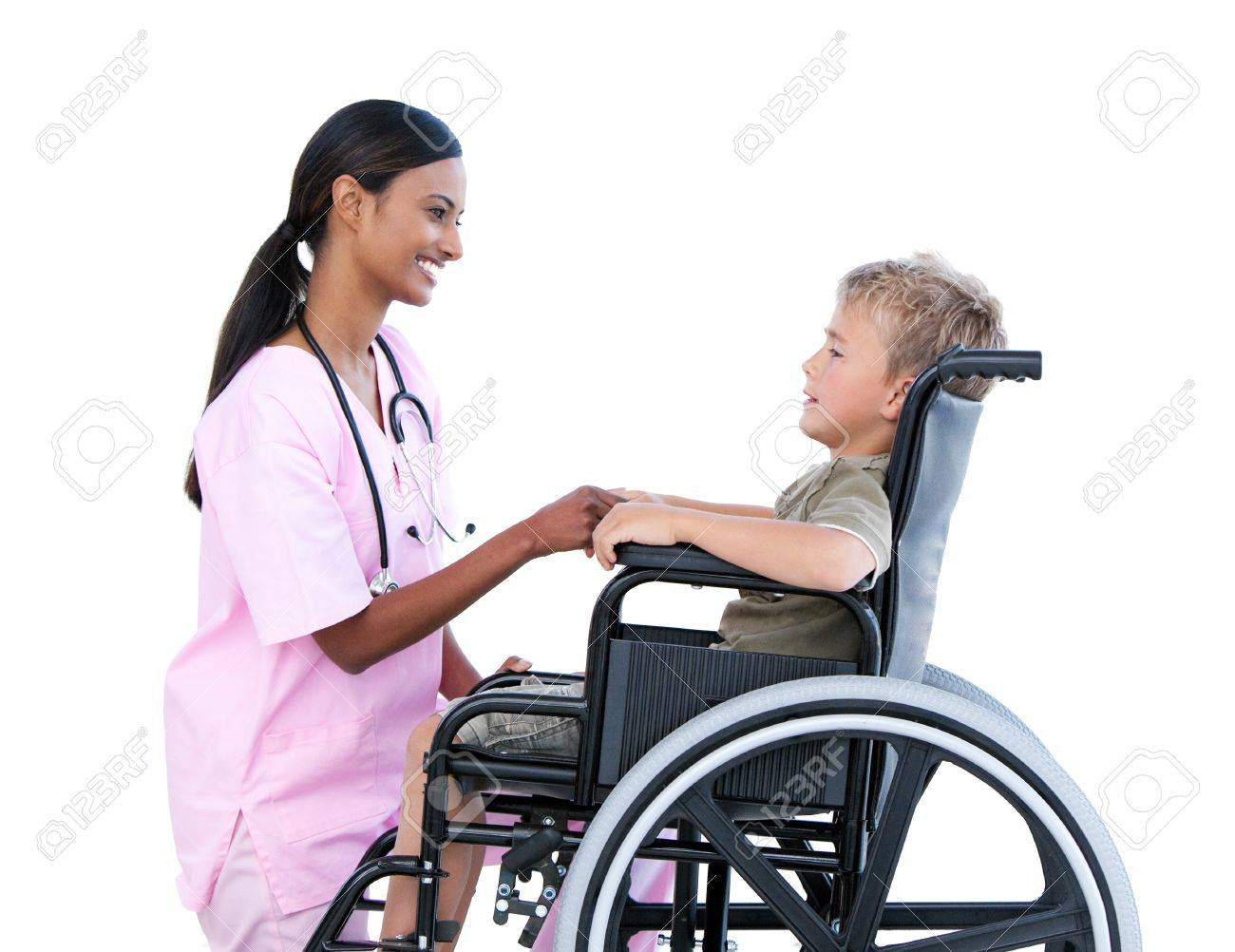 Cute little boy in a wheelchair discussing with his doctor Standard-Bild - 10106308
