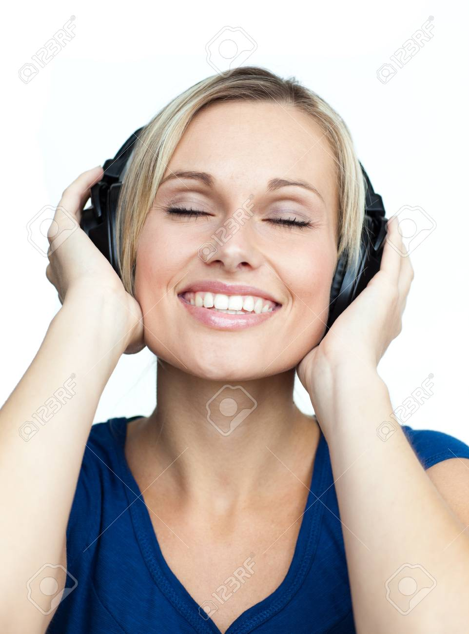 Close-up of woman listening to music with headphones on Stock Photo - 10106969